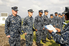 IWO TO (March 12, 2012) Sailors assigned to USS Germantown (LSD 42) receive an honorable discharge before reenlisting atop Mt. Suribachi on the island of Iwo To, formally known as Iwo Jima. Germantown is in the area to participate in the 2012 Reunion of Honor, a ceremony to commemorate the 67th anniversary of the battle of Iwo Jima. (U.S. Navy photo by Mass Communication Specialist 1st Class Johnie Hickmon)