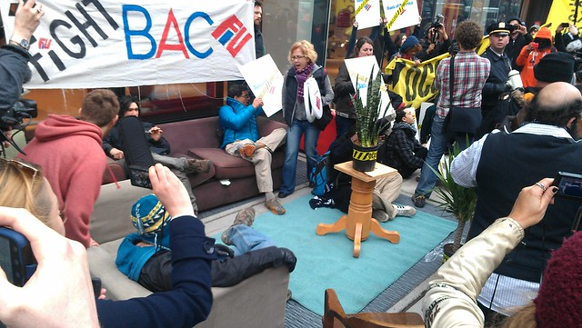 #OWS setting up furniture in front of Bank of America