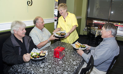 Carol Schrader serves Chicken Salad Chick sandwiches to, from left, Frank Mitchell, Don Schrader and Tom Melton.  Staff/Jeff Stanton  Read more: The Marietta Daily Journal - New Chicken Salad Chick restaurant lets customers choose from 15 different salads