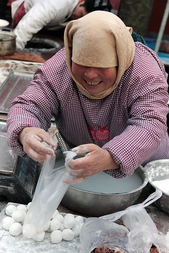 Lady bagging dumplings to be cooked at home