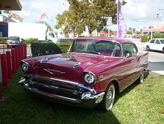 convertible(0.0), chevrolet(1.0), automobile(1.0), automotive exterior(1.0), 1957 chevrolet(1.0), vehicle(1.0), compact car(1.0), antique car(1.0), chevrolet bel air(1.0), sedan(1.0), land vehicle(1.0), luxury vehicle(1.0), coupã©(1.0), motor vehicle(1.0),