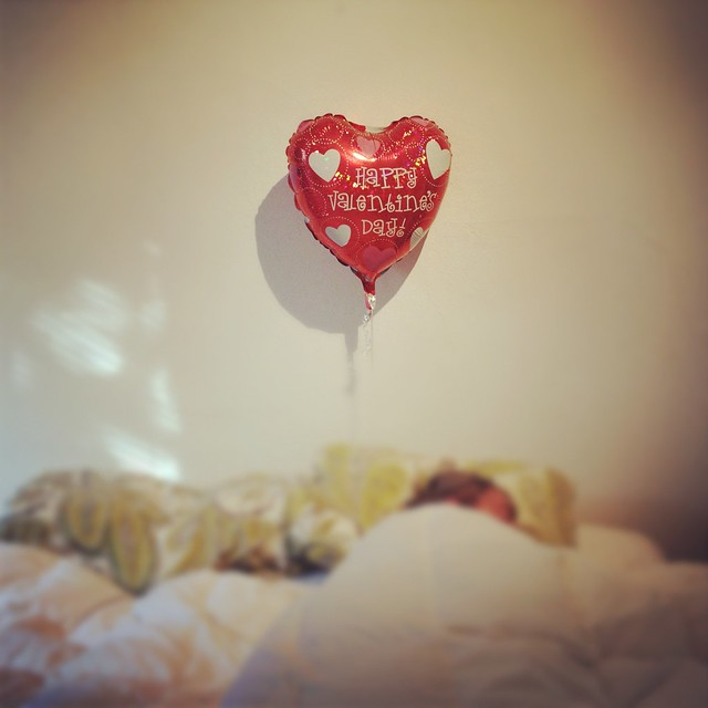 happy valentine 39 s day balloon sleeping man in bed under