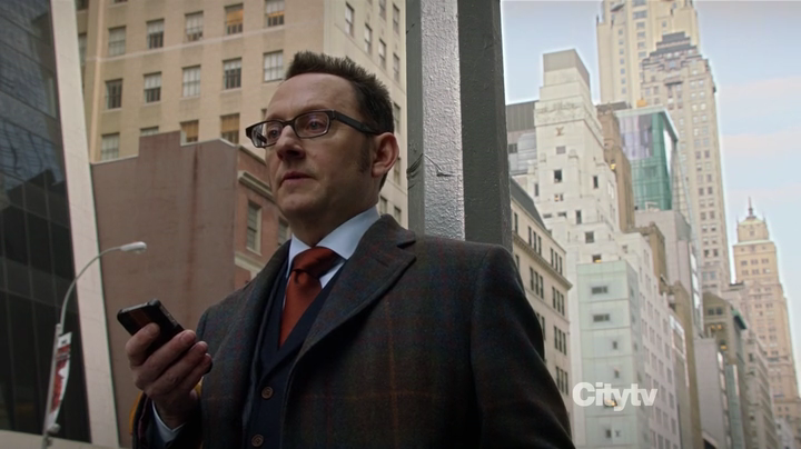Screenshot from Person of Interest showing Harold Finch in a plaid overcoat