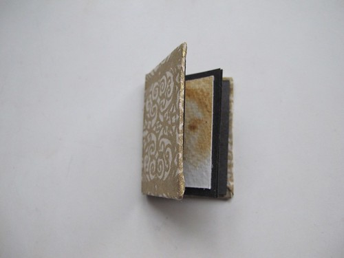 tiny book of sepia portraits