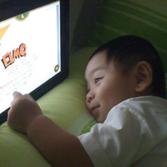 "Reading his favorite ""book"" before going to sleep."