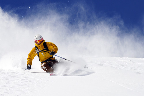 A man skiing on a bluebird powder day at Kirkwood Mountain Resort near South Lake Tahoe, California.