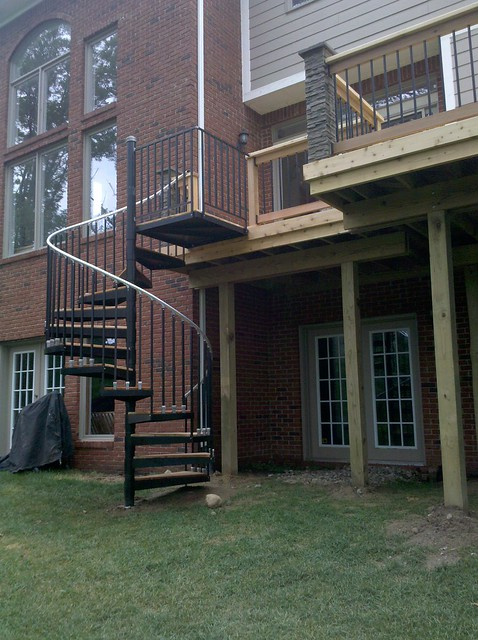 from creative wood products deck with spiral staircase