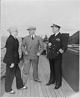 Photograph of Secretary James Byrnes and President Harry S. Truman with Captain James Foskett on the U.S.S. Augusta, 07/11/1945