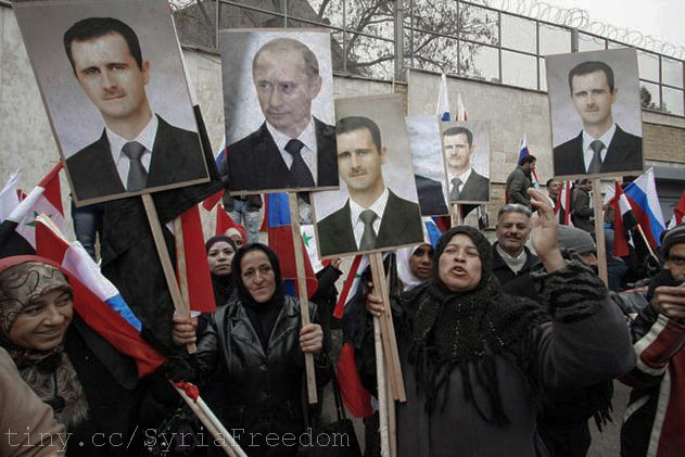 Syrians hold photos of Assad and Putin during a pro-regime protest in front of the Russian embassy in Damascus, Syria, Sunday, March 4, 2012.