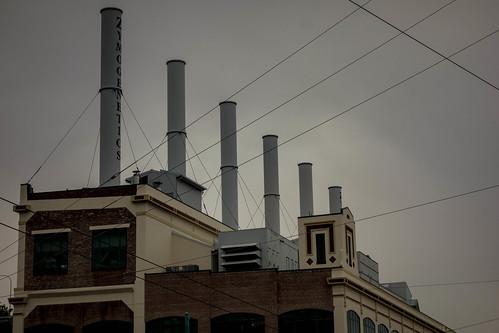 Grey smokestacks, grey sky