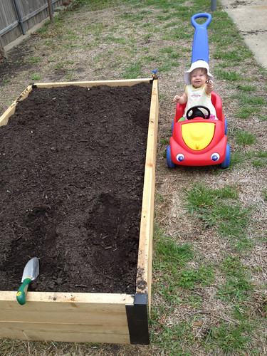 Helping mommy plant (eating dirt)!