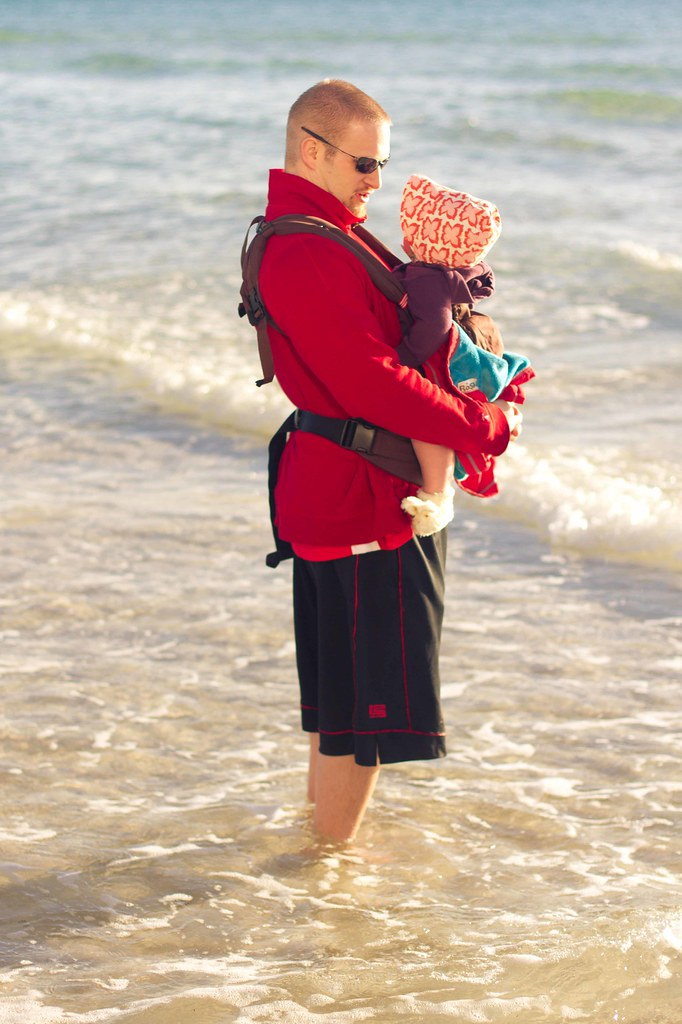 babywearing on the beach.