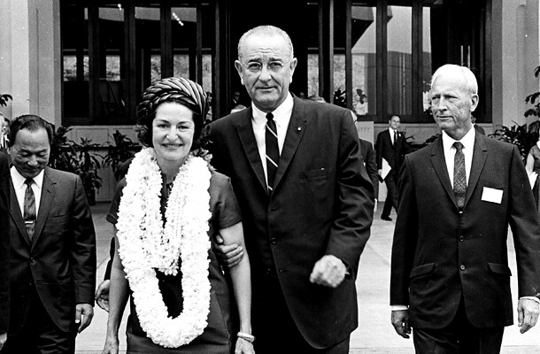 <p>President Lyndon B. Johnson and wife Lady Bird visit the East West Center on October 17, 1966. With the Johnsons are U.S. representative Spark Matsunaga, left, and Hawai'i governor John A. Burns. Johnson also visited UH as vice president in 1961 to receive an honorary degree.</p>