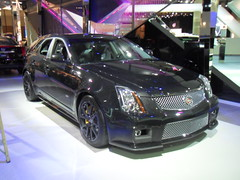 cadillac xts(0.0), automobile(1.0), automotive exterior(1.0), executive car(1.0), cadillac sts-v(1.0), cadillac cts-v(1.0), cadillac(1.0), wheel(1.0), vehicle(1.0), automotive design(1.0), rim(1.0), auto show(1.0), mid-size car(1.0), cadillac sts(1.0), cadillac cts(1.0), bumper(1.0), sedan(1.0), land vehicle(1.0), luxury vehicle(1.0),