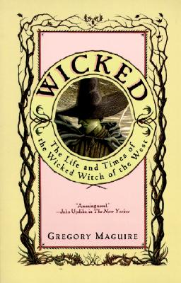 cover of the book Wicked, featuring an illustration of a woman's head. Her skin is green and she's wearing a black hat
