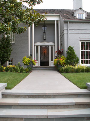New plantings, staircase and garden walls bring this classic home up to date.