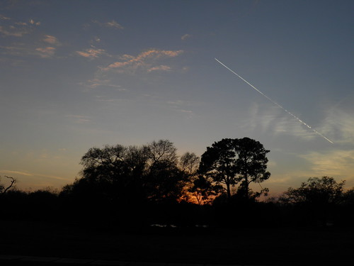 neworleans citypark sunset contrail jet