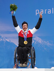 Josh Dueck celebrates Paralympic Gold in the super combined in Sochi, Russia