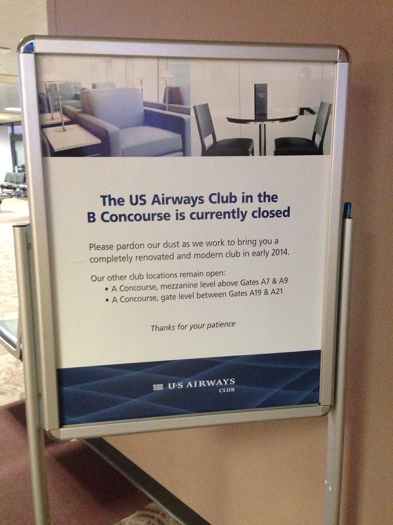 Signs for the US Airways Club