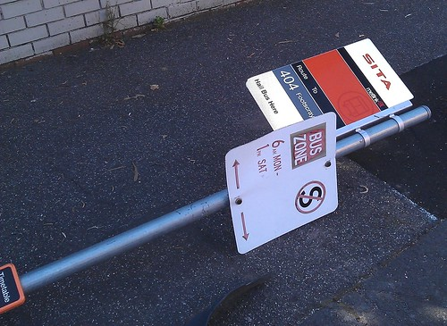 Damaged bus stop sign, route 404