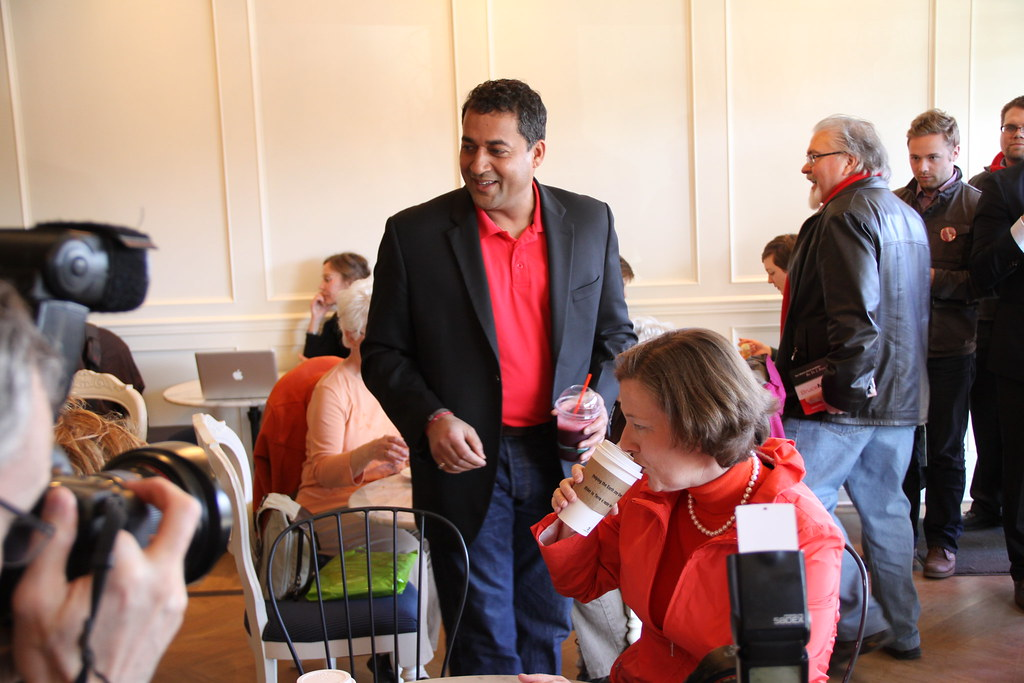 Local candidate Bruce Miller makes a second appearance along with Liberal leader Raj Sherman at Premier Redford's campaign stop at the Duchess Bake Shop.