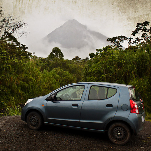 Our little rental car also hunts active volcanoes through the rainforest...
