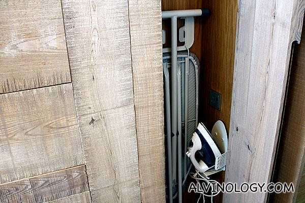 Hidden iron and ironing board behind a nice solid wood cabinet