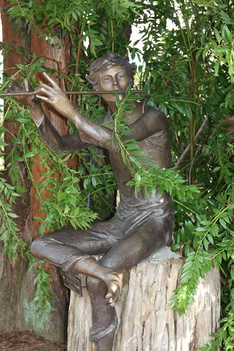 Statue of Boy Playing Flute