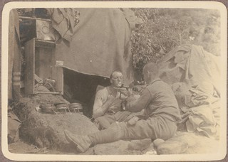 Q.M. Maloney shaving, [as another soldier holds up a mirror for him, June? 1915]