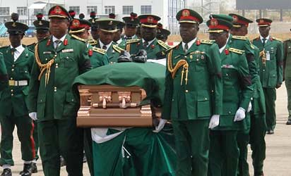 Nigerian military carrying the coffin of Biafran seccesionist leader Chukwuemeka Odumengwu-Ojukwu. The leader spent years in exile and was pardoned in 1982. by Pan-African News Wire File Photos