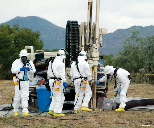 Workers sample contents of LANL's Material Disposal Area B (MDA-B) before excavation