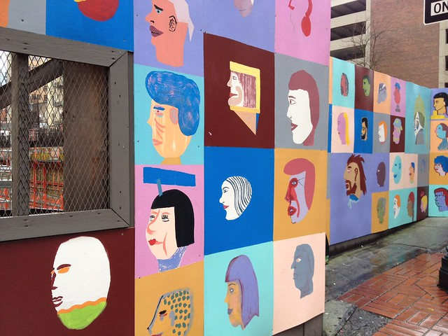 Even Portland's construction sites look good! This one's wrapped in art by Chris Johanson.