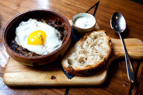 Braised short ribs beef hash with sunny side egg and grilled country bread