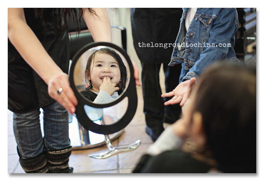 Reagan checking out her new cut in the mirror BLOG