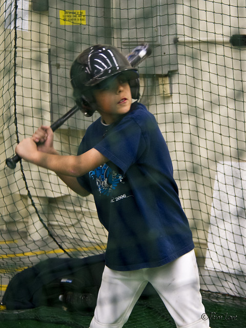 Triple Play batting cages - boy batting