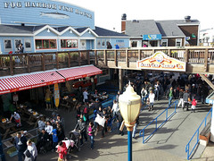 outlet store(0.0), boardwalk(0.0), shopping mall(0.0), town square(0.0), shopping(1.0), town(1.0), market(1.0), tourism(1.0), crowd(1.0), marketplace(1.0), city(1.0), public space(1.0), downtown(1.0), plaza(1.0), walkway(1.0), neighbourhood(1.0), pedestrian(1.0),