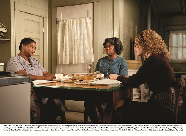 """THE HELP""..TH-006..In Jackson, Mississippi in 1963, Minny Jackson (Octavia Spencer, left), Aibileen Clark (Academy Award¨ nominee Viola Davis, center) and Skeeter Phelan (Emma Stone, right) form an improbable alliance, resulting in a remarkable sisterhoo"