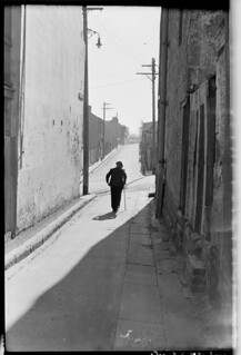 Old age pensioner in Surry Hills alley with stick, Aug 1949, from Series 02: Sydney people & streets, 1948-1950, photographed by Brian Bird