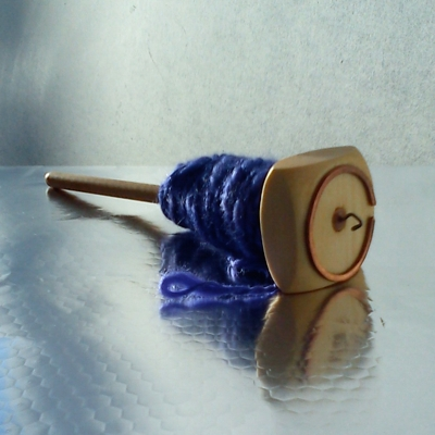 Silk on the spindle - my first spun yarn!