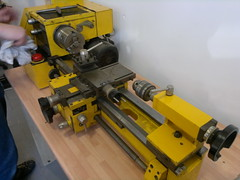 machine(1.0), metal lathe(1.0), tool(1.0), tool and cutter grinder(1.0), machine tool(1.0),