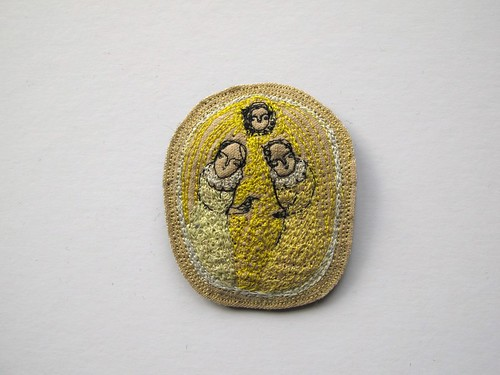 yellow bird in hand brooch