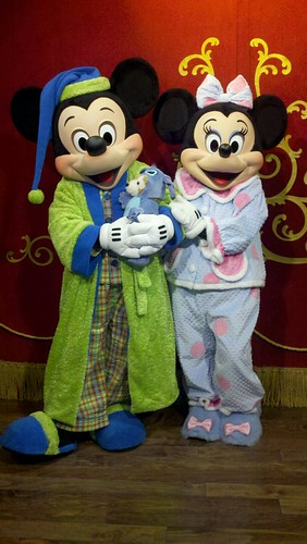 Mickey Mouse and Minnie Mouse in their pajamas in Town Square Theater - One More Disney Day