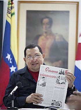 Bolivarian Republic of Venezuela President Hugo Chavez holds up copy of Granma newspaper in Cuba. Chavez was in the country for medical treatment. by Pan-African News Wire File Photos