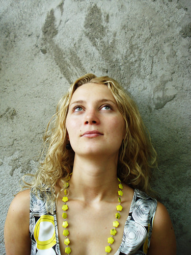 A blonde girl looking up with a longing look on her face