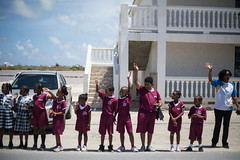 Schoolchildren wave and cheer for the arrival of the Queen's Baton in Grand Turk Island, Turks and Caicos Islands, Thursday 17 April 2014. Turks and Caicos Islands is nation 56 of 70 nations and territories the Queen's Baton will visit....