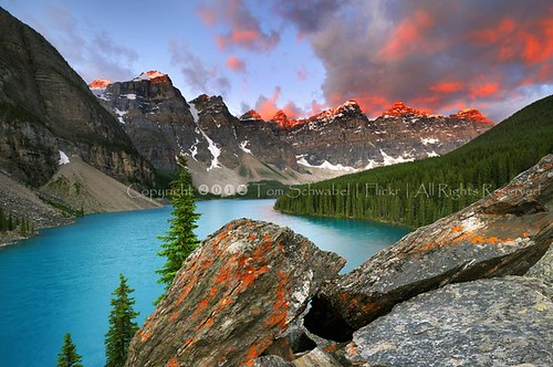 blue lake snow canada mountains tree rock clouds sunrise nationalpark glacier alberta banff lichen lakelouise glacial morainelake tomschwabel