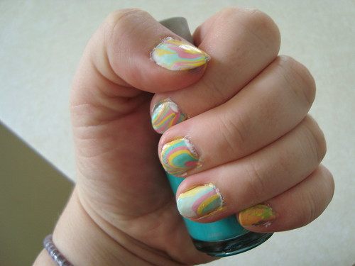 Water colour marbled nails in pink green and yelloq