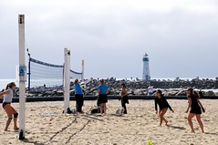 endurance sports(0.0), boardwalk(0.0), walkway(0.0), ball over a net games(1.0), beach(1.0), volleyball(1.0), sports(1.0), sea(1.0), beach volleyball(1.0),