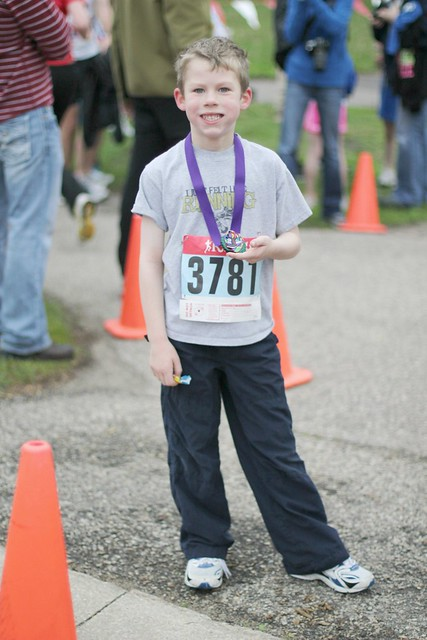 Benjamin finishing the 1 mile race
