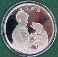 Boy Scout medal  http://www.franklin-mint-silver.com/franklin-mint-rockwell-boy-scouts-medals.htm